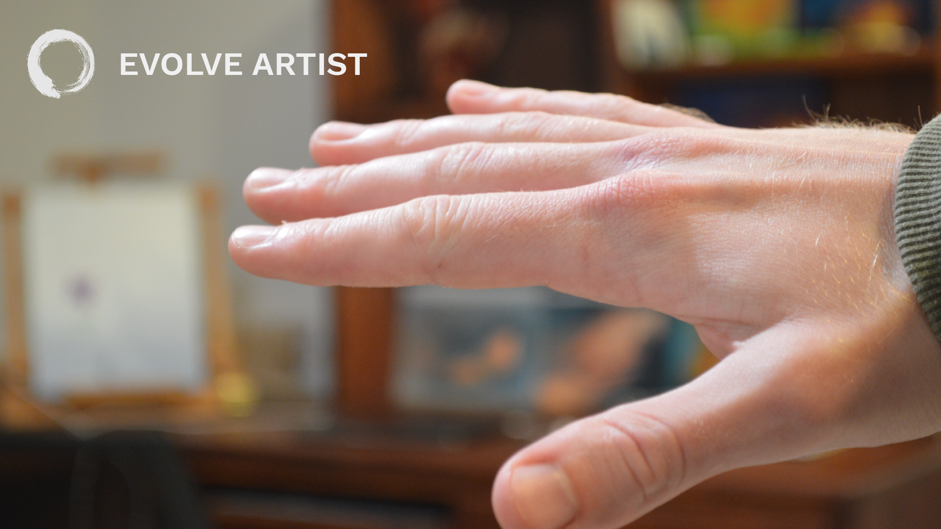 Hand in focus shows how sharp edges pull forward and soft edges push back