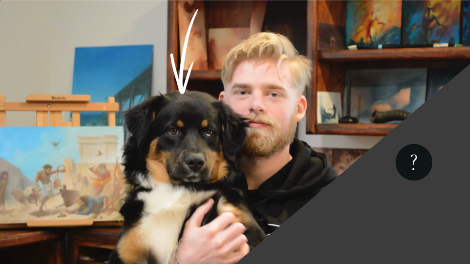 Evolve Artist's Daniel Folta with Carter the dog; arrow pointing at black fur on his head