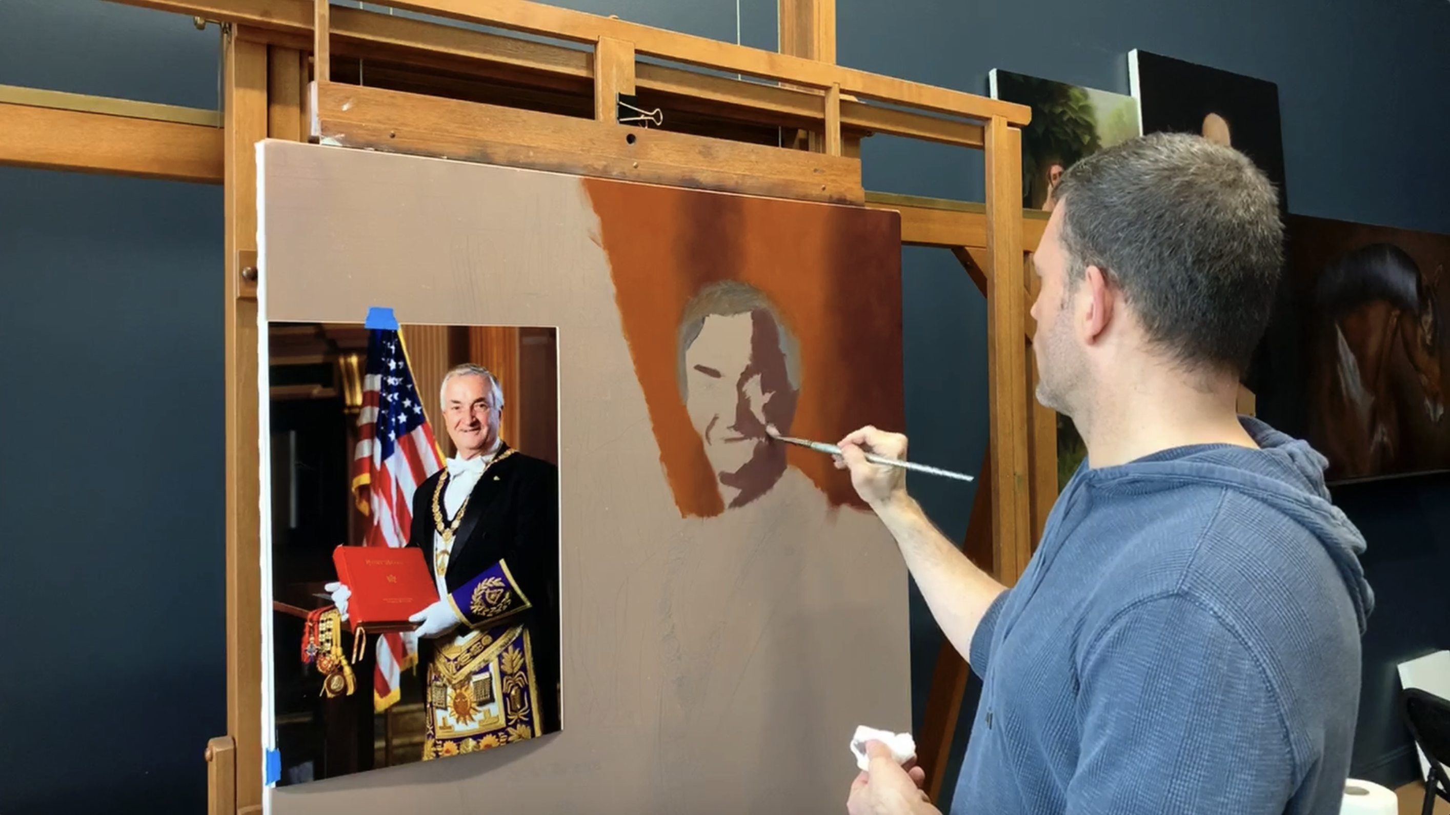 At the start of his portrait painting, Evolve Founder Kevin Murphy begins with one shadow shade and one light shade.